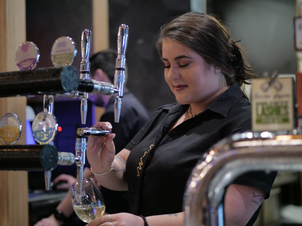 Image of staff member pulling a beer